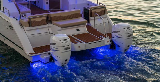 Aquila 36's Outboard motors with underwater lights glowing
