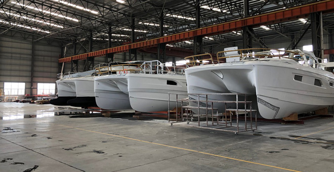Aquila Catamarans light up in factory warehouse
