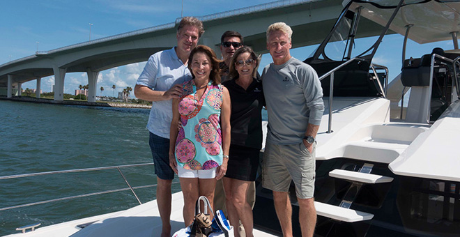 Owners Bruce and Cydne Cooley with friends on their Aquila 48 Power Catamaran