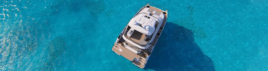 Aerial view of an Aquila 54 power catamaran in the water