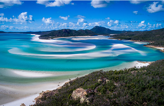 An aerial shot of the blue water in an inlet in the Whitsunday Islands