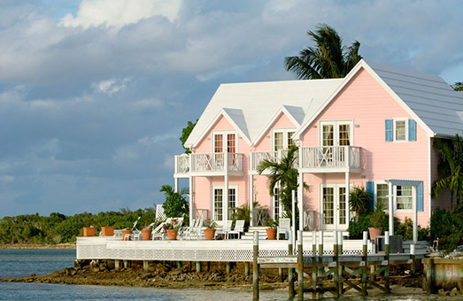 A pink house on the water overlooking the Abacos coastline