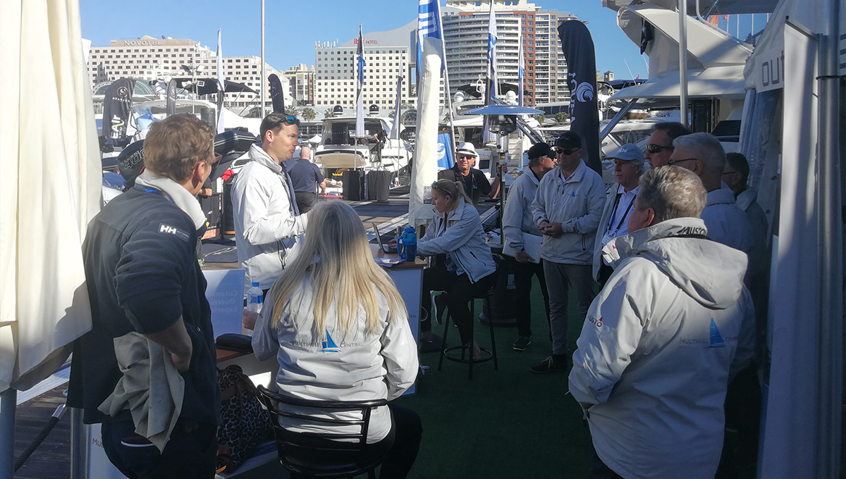dealer on the dock with team at sydney international boat show