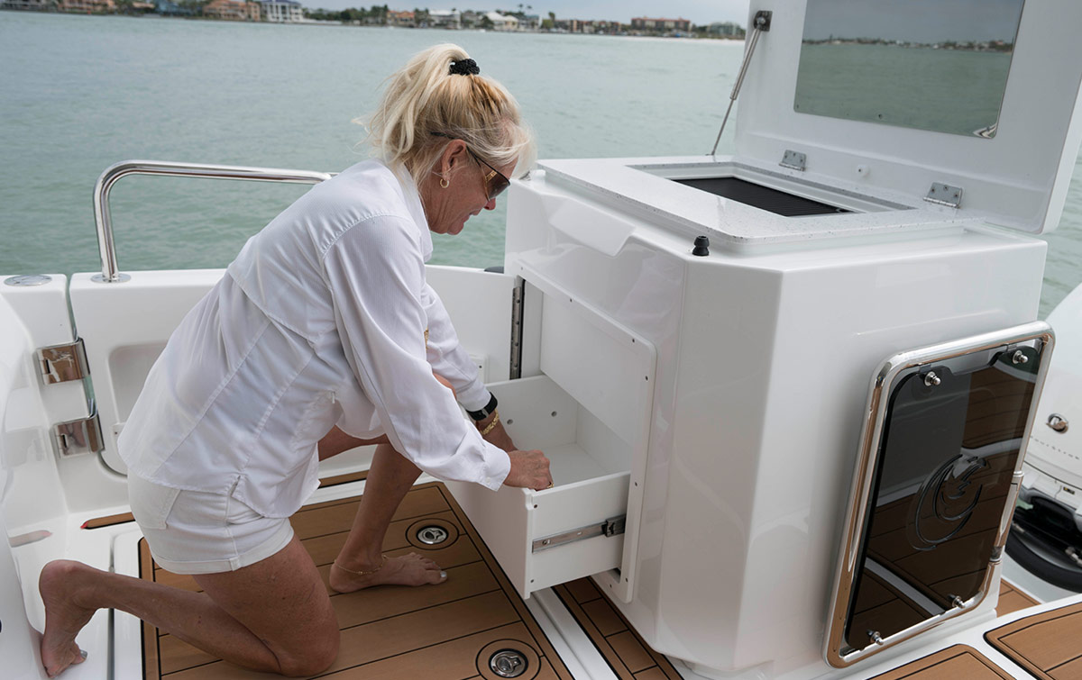 lady opening drawers on the aquila 36 fishing and diving version