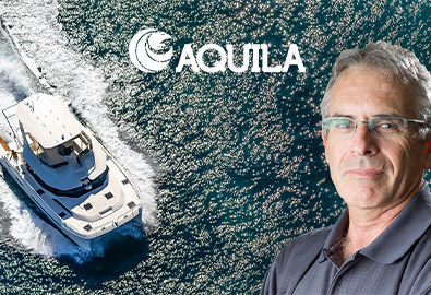 An Aquila power catamaran with Aquila president Lex Raas