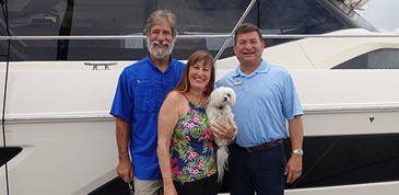 Owners photographed in front of their Aquila, named after their one eyed dog see in the photo