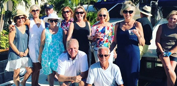 Group smiling celebrating becoming owners of Aquila boat
