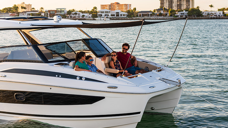 Family sitting in bow of Aquila 32 Sport Power Catamaran with shade from sun