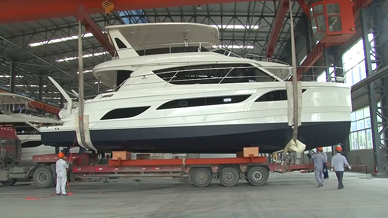 Aquila Boat loaded on trailer in factory