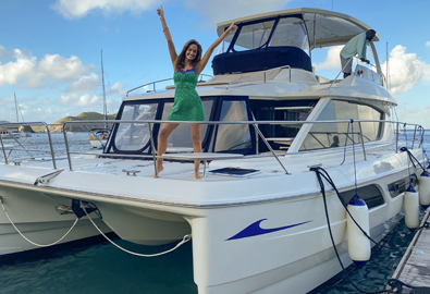 A Sports Illustrated swimsuit model aboard a MarineMax Vacations power catamaran